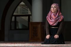 Humble Muslim Prayer Woman. Young Muslim Woman Praying In Mosque Royalty Free Stock Photography