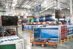 Costco Wholesale with row of big screen, smart TVs display