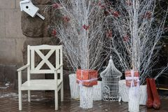 Santa chair near white trees and boxes with presents Stock Image