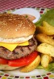 Humburger. Cheesburger fries tomato cheese Royalty Free Stock Image