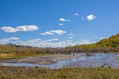 humedal y nubes en el otoño Imagenes de archivo