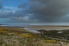 Humeurige skys Severn Estuary Stock Foto's