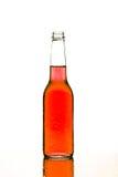 Humide rouge de bouteille d'isolement sur le blanc Photographie stock