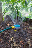 Humidification compost pile using sprinkler Royalty Free Stock Photography