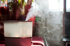 Humidifier. Spreading steam into the living room Royalty Free Stock Images