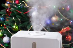 Humidifier in the house. On the background of a Christmas tree Stock Photography