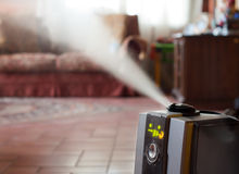 Humidifier with ionic air purifier. Digital humidifier with ionic air purifier at home interior Stock Image
