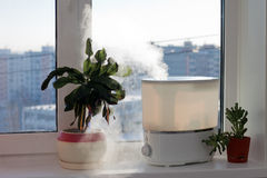 Humidifier. Spreading steam into the living room Royalty Free Stock Photo