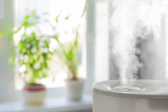Humidifier spreading steam Stock Photo