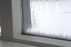 Humidity at a window. Strong humidity at a window in wintertime royalty free stock photos