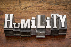 Humility word in metal type. Humility word in mixed vintage metal type printing blocks over grunge wood Stock Photography