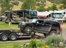 A hummer being removed from a trailer at a campground in colorado Royalty Free Stock Images