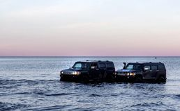 Hummer H3 overcoming a water barrier. Leningrad region. Leningrad region. Russia, November 4, 2018: Hummer H3 overcoming a water barrier. Leningrad region . H3 royalty free stock images