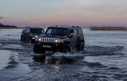 Hummer H3 overcoming a water barrier. Leningrad region. Leningrad region. Russia, November 4, 2018: Hummer H3 overcoming a water barrier. Leningrad region . H3 royalty free stock photos