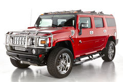 Hummer H2. Patriot edition shiny red 4x4 shot in studio Stock Images