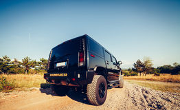 Hummer H2 on the road. Stock Photo