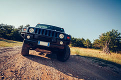 Hummer H2 on the road. Royalty Free Stock Photos