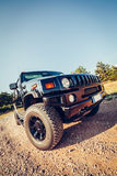 Hummer H2 on the road. Stock Photography