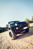 Hummer H2 on the road. Stock Images