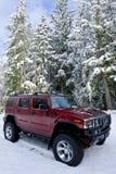 Hummer H2 dans la neige Photographie stock libre de droits