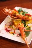 Hummer med röd currysås, thailändska matar. fotografering för bildbyråer