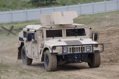 Hummer. Modern army armored personnel carrier on the battlefield stock images