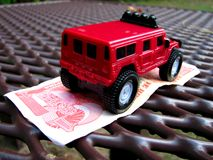 Hummer toy. Red hummer toy and currency Stock Photo