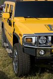 Hummer Yellow. Fragment Hummer yellow. The machine costs on a grass Stock Photo