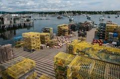 Hummerfällor på en fiskeskeppsdocka i Maine Royaltyfria Foton