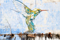 Hummingbird wall art painted by famous artist, Ernest Zacharevic in Ipoh Royalty Free Stock Images