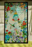 HUMMINGBIRDS STAINED GLASS HANGING Stock Photos