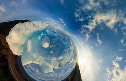 Hummocks on blue ice of Lake Baikal from Olkhon. Spherical 360 panorama little planet.  royalty free stock photos