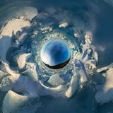 Hummocks on blue ice of Lake Baikal from Olkhon. Spherical 360 panorama little planet.  royalty free stock image