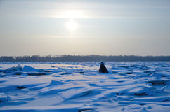 The hummocks and the buoy  on the river in winter under the sun Stock Images