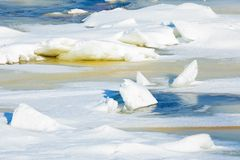 The hummocks and floes on the winter river stock photo