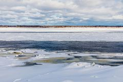 The hummocks and floes on the winter river stock image