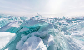 Hummocks of of lake baikal ice in a stretched widescreen format. Blue hummocks of of lake baikal ice in a stretched widescreen format Stock Photography