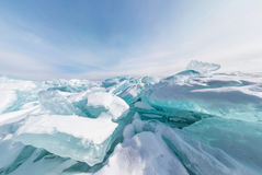Hummocks of of lake baikal ice in a stretched widescreen format. Blue hummocks of of lake baikal ice in a stretched widescreen format Stock Photo
