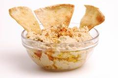 Hummus 01. Bowl of hummus with pita wedges royalty free stock photography