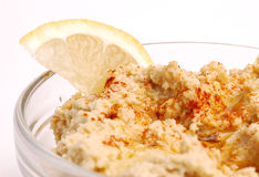 Hummus 02. Close-up of hummus with a lemon wedge Royalty Free Stock Image