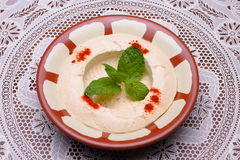 Hummus. Mashed chickpeas and tahina, lebanese cuisine Royalty Free Stock Images