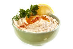 Hummus. Bowl of hummus, with olive oil and paprika, isolated on white Stock Images