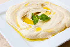 Hummus. White plate with fresh hummus libanese food Royalty Free Stock Images