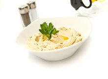 Hummus. Bowl of hummus with parsley and olive oil Stock Image