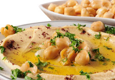 Hummus. Chickpeas with olive oil over white background Stock Photography