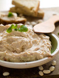 Hummus. Bowl of fresh hummus dip with bread slices, selective focus royalty free stock image