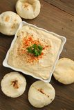 Hummus. Top view of hummus with breads on a wooden table royalty free stock photography
