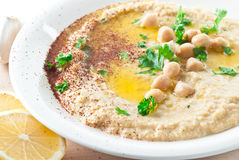Hummus. Topped with olive oil, paprika and parsley stock image