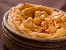 Hummus. Freshly made hummus with chick-pea and paprika, selective focus royalty free stock image