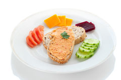Hummus. Two Sesame Bread Slices with Hummus Spread, Tomato, Beetroot, Cucumber and Cheese on a White Plate Royalty Free Stock Photos